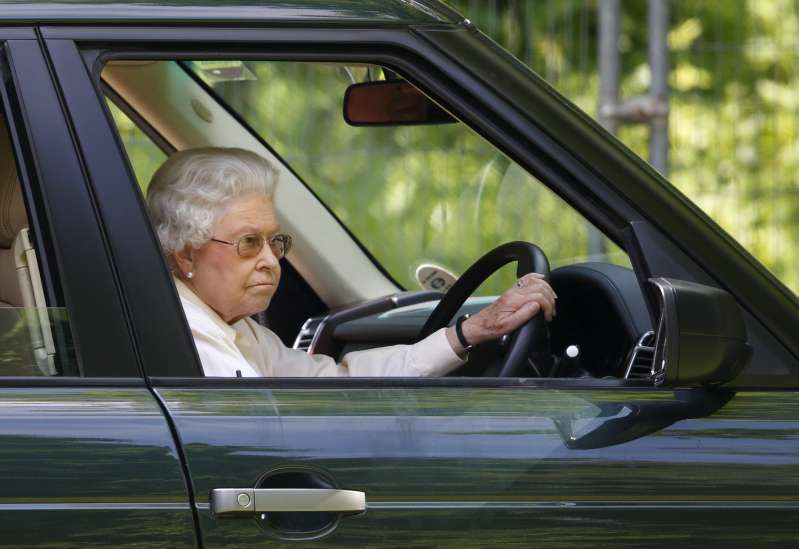 Queen drives a car