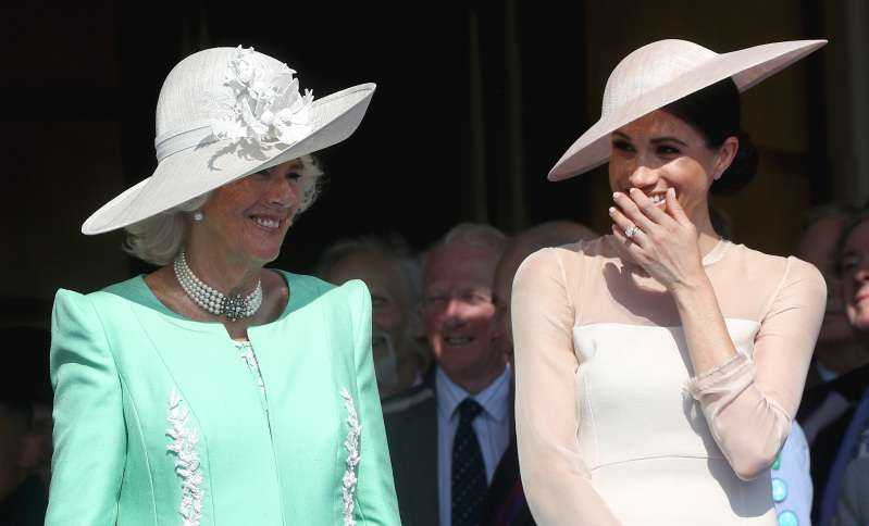 Borrowed From Meghan? The Duchess Of Cornwell Was Spotted With A Handbag Identical To Markle's