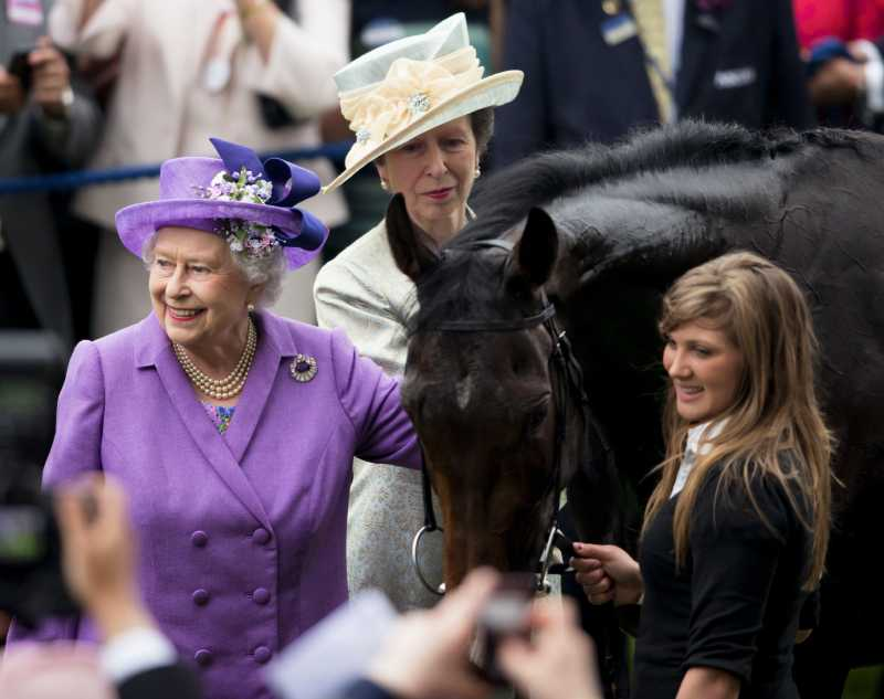 Princess Anne, The Princess Royal looks on as Queen Elizabeth II pats her Gold Cup winning horse Estimate on Ladies Day of Royal Ascot