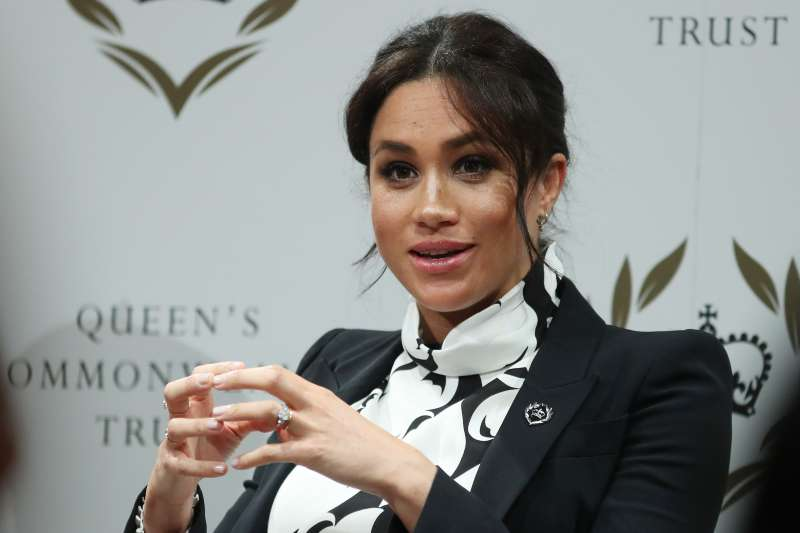 Gift From Her Majesty? Meghan Markle Gets A New Brooch Of Queen's Commonwealth Trust LogoGift From Her Majesty? Meghan Markle Gets A New Brooch Of Queen's Commonwealth Trust Logo