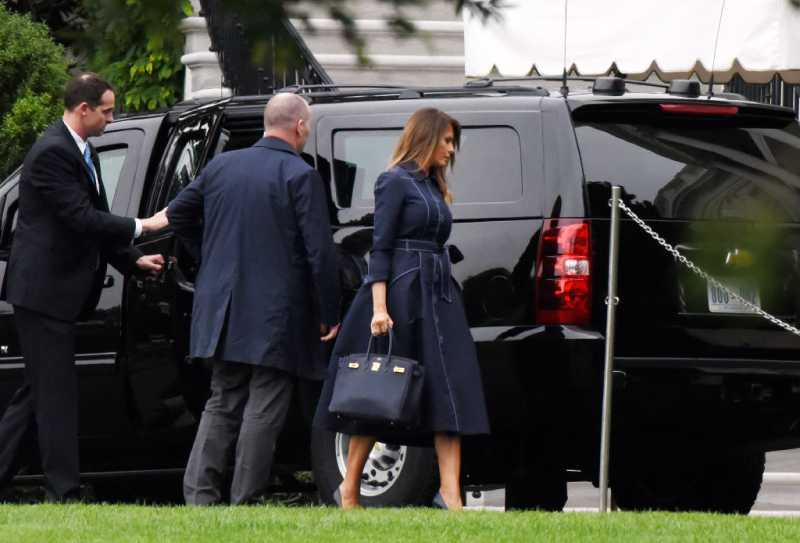 First Lady Melania Trump walks back to the Residence as she arrives at the White House following a trip to Shanksville