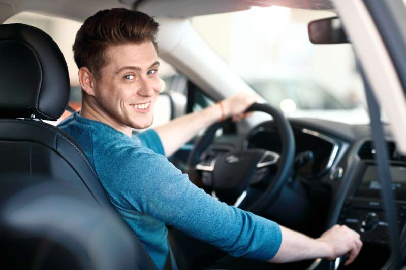 Not So Macho After All: What A Man's Driving Habits Can Tell About HimHappy young male driver behind the wheel. The guy in the car. Lifestyle scene in the car dealership