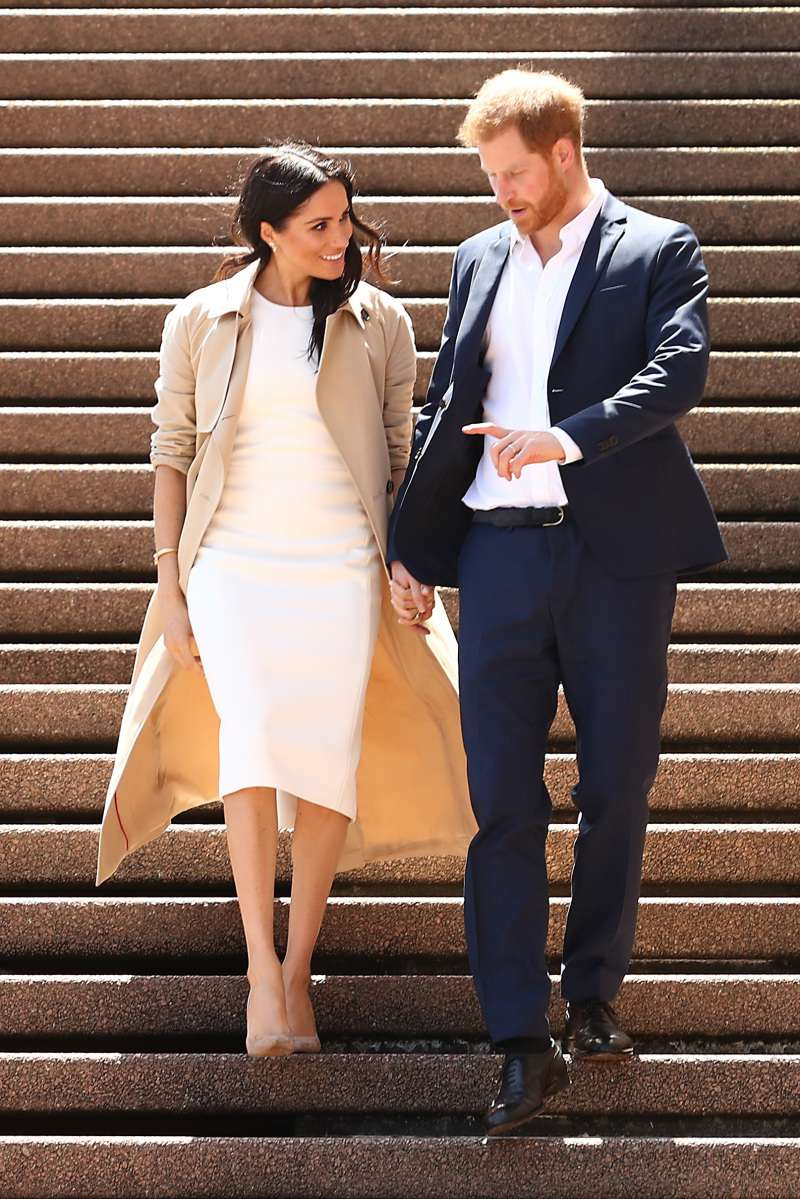 Hard Times For High Heels? Pregnant Meghan Markle Was Spotted Changing Her Footwear In Australiameghan markle and prince harry in australia