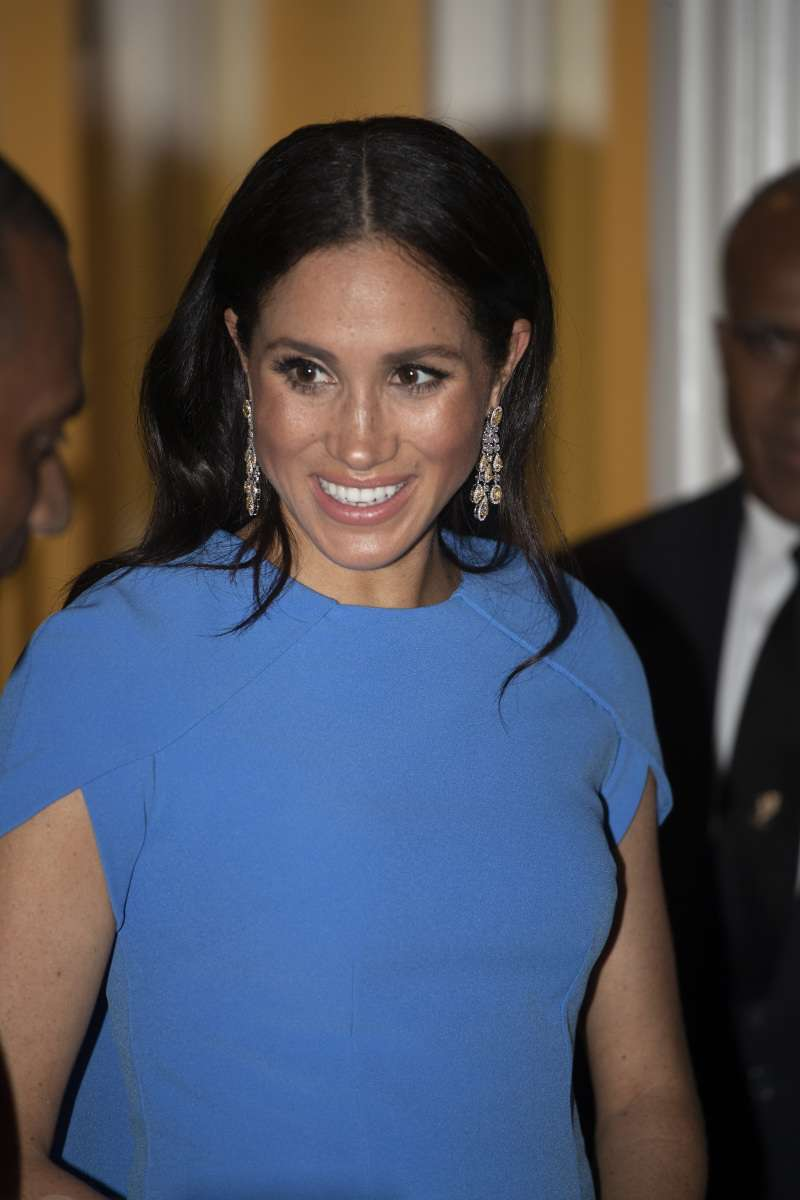 The Smart Reason Why Meghan's Arms Looked Wet And Extra Shiny In Tonga