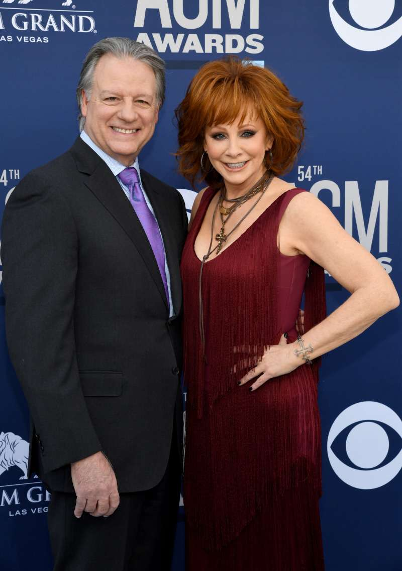 Reba McEntire Stuns In A Fringed Burgundy Dress At ACM Awards And Shows Off Her New Boyfriend