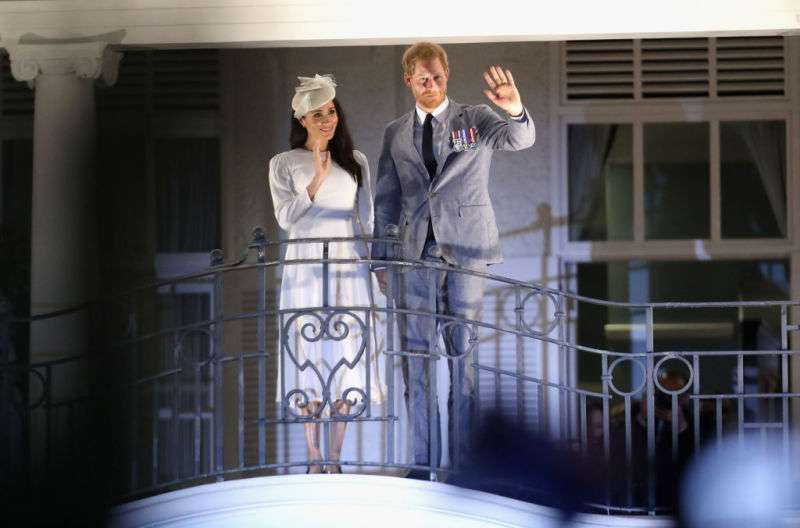 Déjà Vu! Prince Harry And Meghan Markle Recreate 65-Year-Old Historical Moment As They Wave To The Crowd From Hotel Balcony In Fiji