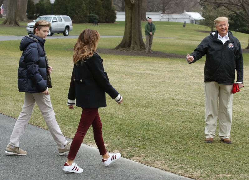 Casual Glamour: Melania Trump Flaunts Her Perfect Shape In Skinny Maroon Trousers And Adidas Trainers On Her Way To Alabama With Donald And BarronCasual Glamour: Melania Trump Flaunts Her Perfect Shape In Skinny Maroon Trousers And Adidas Trainers On Her Way To Alabama With Donald And Barron