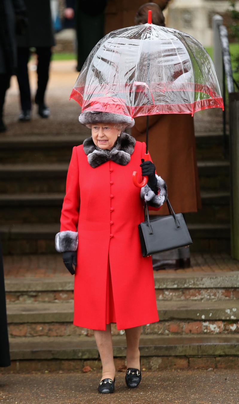 queen elizabeth II with red umbrella