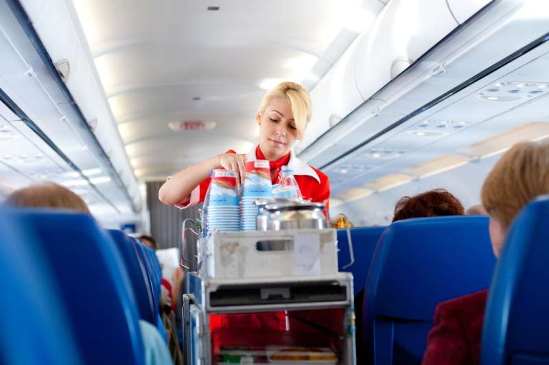 Flight Attendants Don't Drink Tea Or Coffee On The Plane As Water May Contain Certain Harmful Bacteriaair hostess  serves drinks out on board