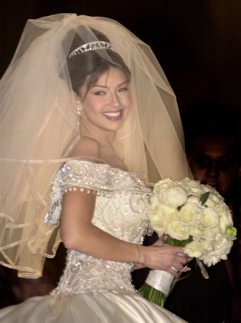 18 Years After Thalia And Tommy Mottola S Wedding Details About Her Iconic Dress Come To