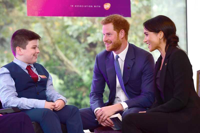 Prince Harry, Duke of Sussex and Meghan, Duchess of Sussex meet 12 year old Jake Stacey during the annual WellChild awards
