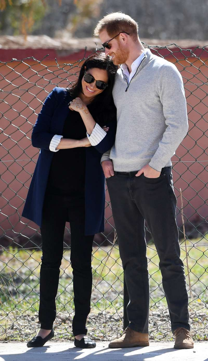 Did The Baby Kick? Meghan Markle Glances Down Meaningfully At Her Baby Bump While At An Event In Morocco