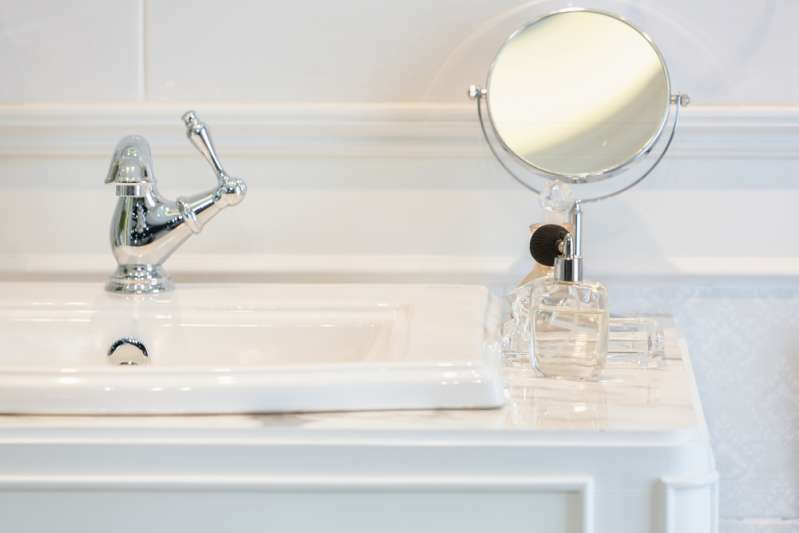 8 Awesome Cleaning Hacks That Can Help You Make Your House Sparkle8 Awesome Cleaning Hacks That Can Help You Make Your House Sparkle8 Awesome Cleaning Hacks That Can Help You Make Your House Sparkle8 Awesome Cleaning Hacks That Can Help You Make Your House SparklePerfume bottles on white washbasin counter top inside a classic style bathroom