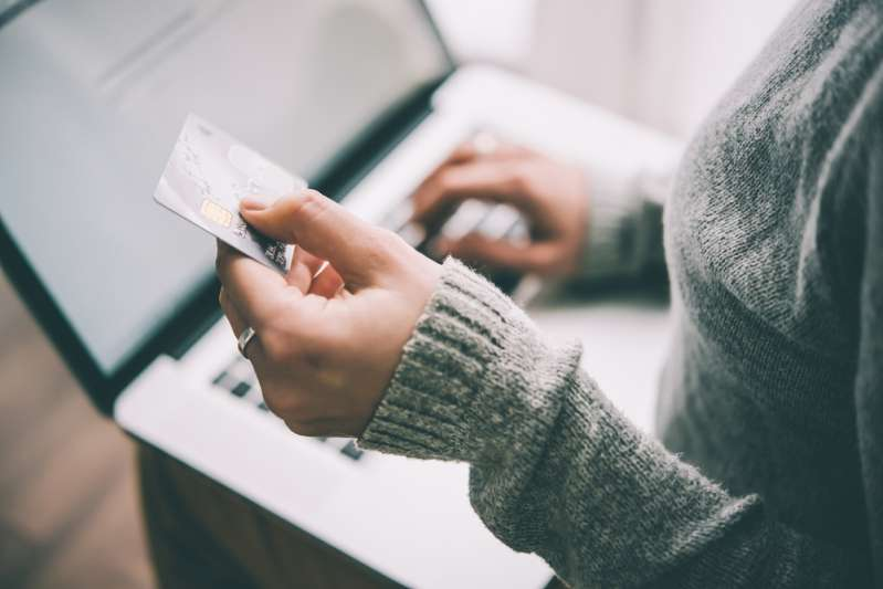 Want To Get Fast Money? Here Are 5 Modern Ways Of Making Easy Money Without Any CreditsWoman uses her laptop to buy something online with a credit card
