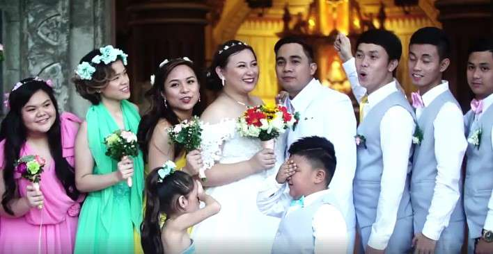 Hilarious Video: Little Page Boy Hijacks The Spotlight As He Managed To Steal A Kiss During The Wedding Photoshoot