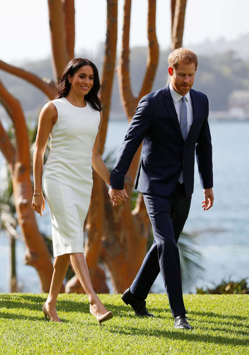 Glowing Meghan Markle Debuted Her Baby Bump For The First Time In A Stunning Pure White Dress