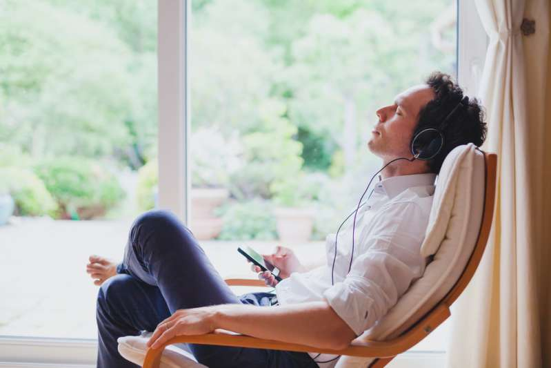 5 Most Antisocial Zodiac Signs That Don't Like Being Around PeopleRelaxed man in headphones sitting in a chair