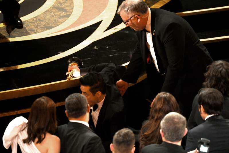 Rami Malek Slips Up And Falls Off Stage After Winning The Best Actor Award At Oscars