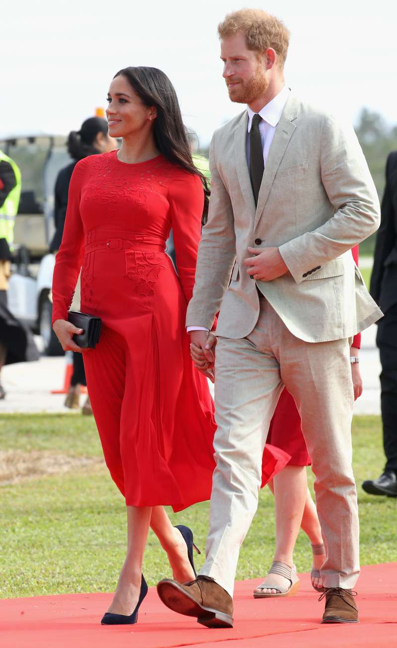 Meghan Markle Stuns In A Ravishing Red Dress As Her Gorgeous Baby Bump Takes Center Stage Once AgainMeghan Markle Stuns In A Ravishing Red Dress As Her Gorgeous Baby Bump Takes Center Stage Once AgainMeghan Markle Stuns In A Ravishing Red Dress As Her Gorgeous Baby Bump Takes Center Stage Once Againmeghan markle and prince harry in tonga