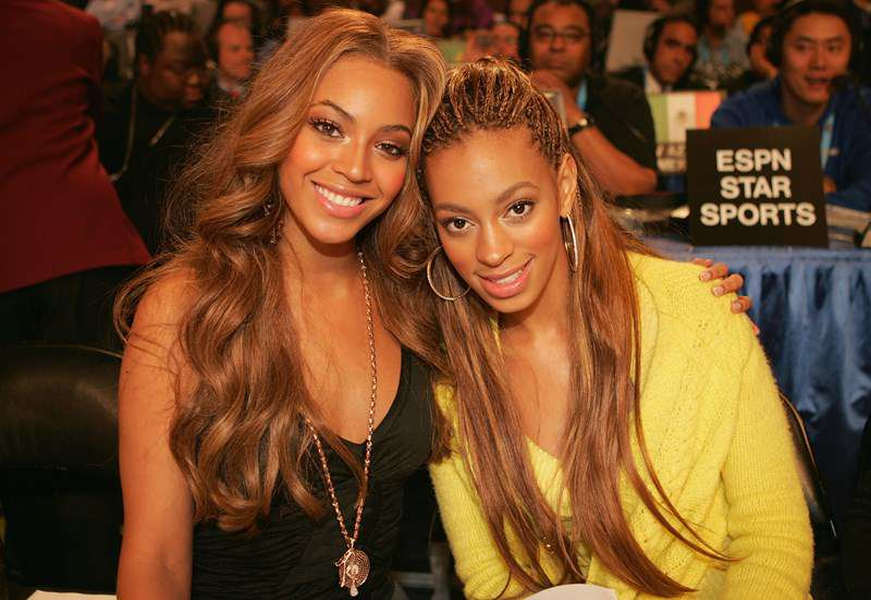 Beyonce Knowles and her sister Solange Knowles pose together at the 2005 NBA All Star Game