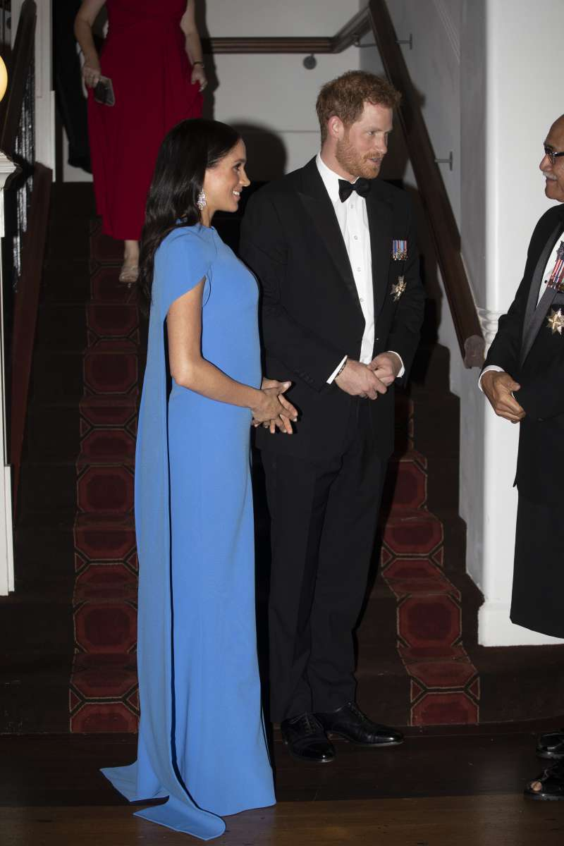Pure Perfection: Duchess Meghan Mesmerizes The Public With Diamonds And A Luxurious Floor Length Blue Dress At The Reception In Fiji