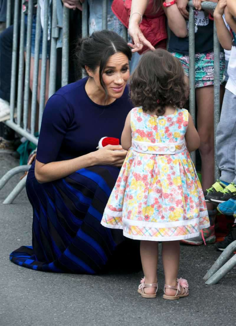 She'll Do It Her Way: Meghan Markle Plans To Raise Her Children Differently Than Kate Middleton, Reports SayMegan, Duchess of Sussex speaks to little Catalina Rivera, 2, who got through the railings during a walkabout at Government Gardens