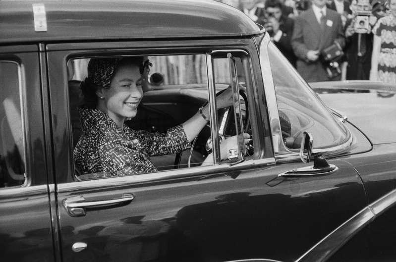 Queen drives a car
