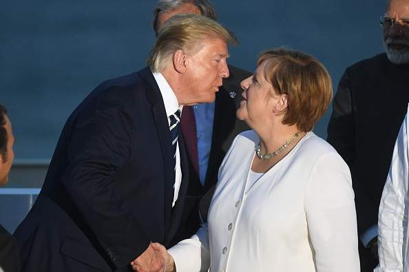 """""""No Lips Required:"""" Donald Trump Tries To Kiss Angela Merkel In An Awkward Moment At G-7 Summit And Twitter Users Can't Keep Calm"""