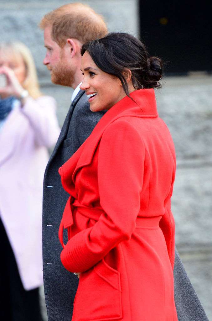 Meghan Markle And Prince Harry Arrived In Birkenhead And The Duchess Steals The Spotlight In A Bright Colored Outfit That Showed Off Her Precious Baby Bump